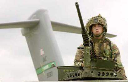 US TROOPS TO FIGHT I...
