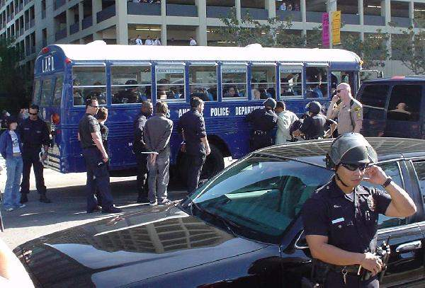 Police Move Arrestee...