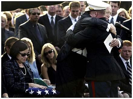Father Embraces Mari...