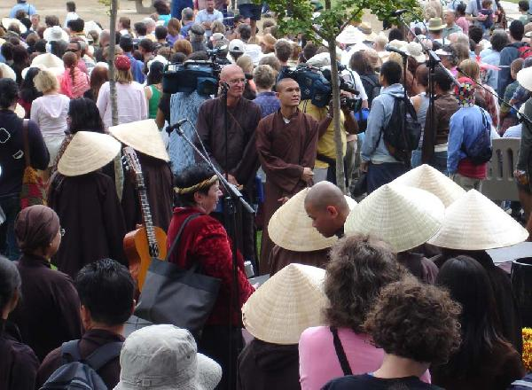 Monks Watch as Crowd...