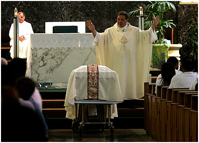 Priest Says Mass...