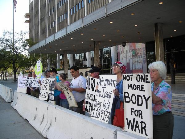 4000 death vigil Dow...