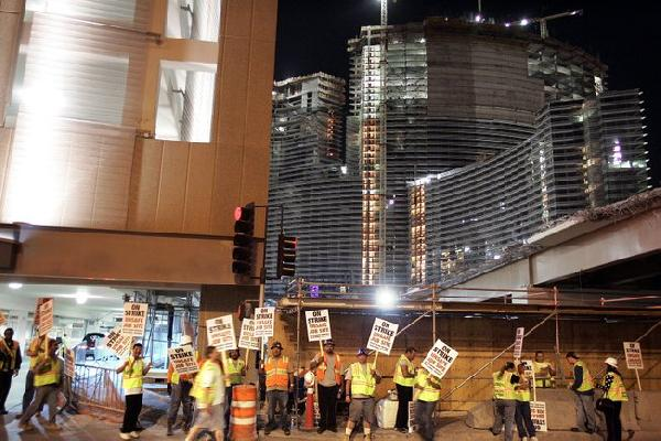 Workers walk off MGM...