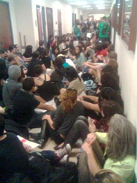 Students sit in at U...