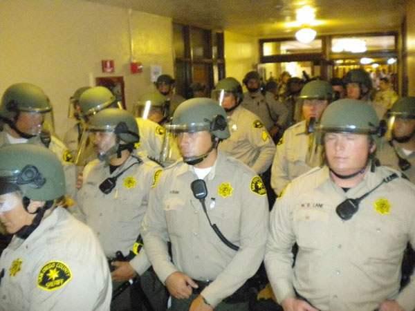 50 Cops in Riot Gear...