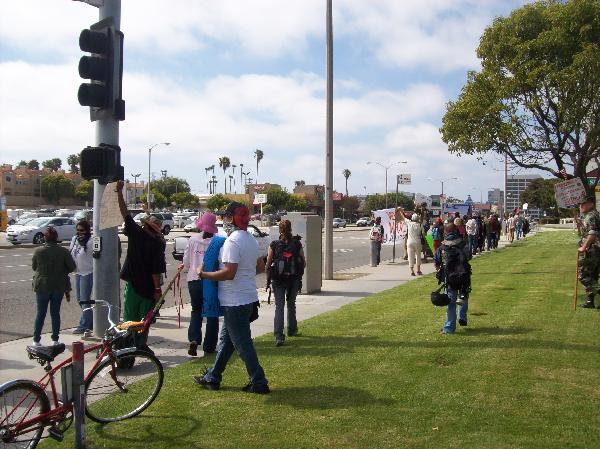 Protestors pass lawn...