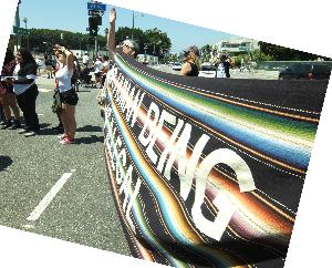 Blanket Fabric Banner: No Human Being Is Illegal
