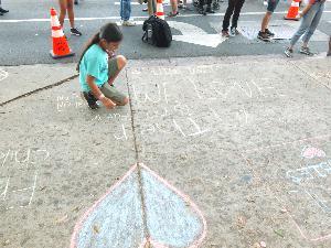 Girl Chalking Sidewalk